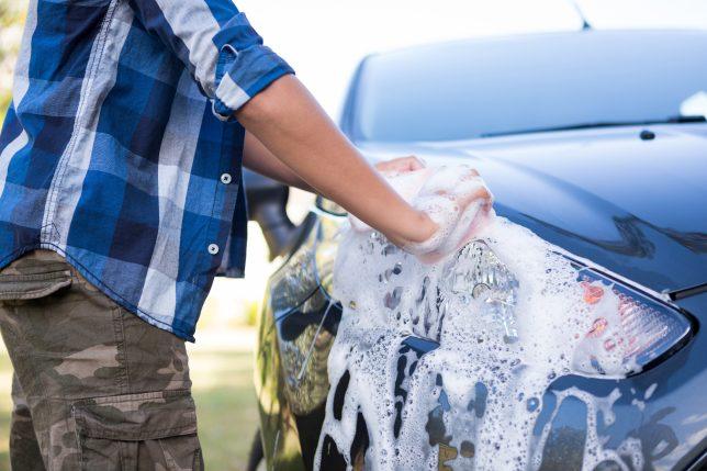 Grown-up washing car